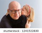 cute loving little blond girl... | Shutterstock . vector #1241522830