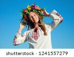happy girl in traditional... | Shutterstock . vector #1241557279