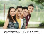 happy young asian people... | Shutterstock . vector #1241557993