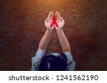 red ribbon in women hands for... | Shutterstock . vector #1241562190