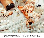 Small photo of a lot of sea theme in mess like shells, candles, perfume, girl s