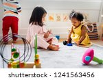 little kids playing toys in the ... | Shutterstock . vector #1241563456