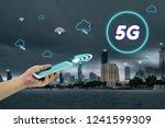 hand holding mobile smart phone ... | Shutterstock . vector #1241599309