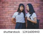face of two asian teenager... | Shutterstock . vector #1241600443