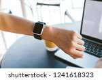 woman using smartwatch with e... | Shutterstock . vector #1241618323
