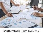 business team meeting working... | Shutterstock . vector #1241632219