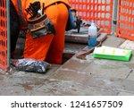 worker with orange overalls...   Shutterstock . vector #1241657509
