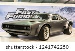 """Small photo of LAS VEGAS, NV/USA - NOVEMBER 2, 2018: A 1968 Dodge Charger R/T in the """"Fast and Furious"""" (Fate of the Furious, F8) movie, at the Specialty Equipment Market Association (SEMA) auto trade show."""