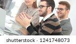 smiling business team sitting... | Shutterstock . vector #1241748073