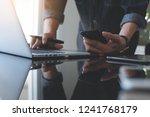 multitasking business man using ... | Shutterstock . vector #1241768179