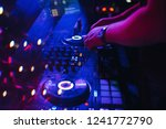 dj plays with his hands on a... | Shutterstock . vector #1241772790