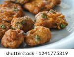 thai style spicy fried fish cake   Shutterstock . vector #1241775319