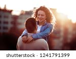 handsome man carring his... | Shutterstock . vector #1241791399