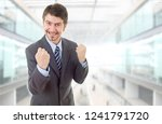 happy business man winning  at... | Shutterstock . vector #1241791720