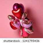 girl with colorful hearts air... | Shutterstock . vector #1241793436