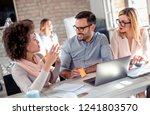 business partners looking at... | Shutterstock . vector #1241803570