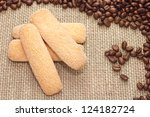 Traditional Italian sugar biscuit cookies with coffee beans on sacking background - stock photo