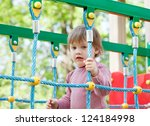 two year child at playground... | Shutterstock . vector #124184998