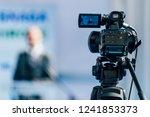 cameraman recording well... | Shutterstock . vector #1241853373