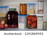 Small photo of Storage shelves in pantry with homemade canned preserved fruits and vegetables