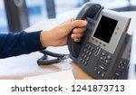 close up helpdesk employee man... | Shutterstock . vector #1241873713
