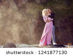 beautiful young couple hugs and ... | Shutterstock . vector #1241877130