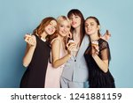 women celebrate the holiday... | Shutterstock . vector #1241881159