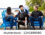 multiracial couple sitting with ... | Shutterstock . vector #1241888080