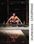 tensing man lifting barbell in... | Shutterstock . vector #1241890660