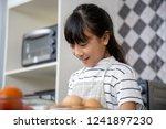 little girl cooking vegetables | Shutterstock . vector #1241897230