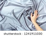 female hand touching smooth... | Shutterstock . vector #1241911030