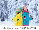 children playing with snow in... | Shutterstock . vector #1241947900
