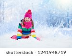 child playing with snow in... | Shutterstock . vector #1241948719