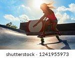 skateboarder in action. black... | Shutterstock . vector #1241955973
