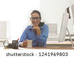 businesswoman sitting at desk... | Shutterstock . vector #1241969803