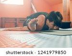 female doing advanced kurmasana ...   Shutterstock . vector #1241979850