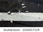 road markings on asphalt on the ... | Shutterstock . vector #1242017119