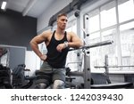 athletic man goes in for sports ... | Shutterstock . vector #1242039430