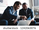 business executives discussing...   Shutterstock . vector #1242063076