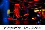 young beautiful couple talking... | Shutterstock . vector #1242082003