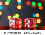 two red glass dice on a... | Shutterstock . vector #1242086269