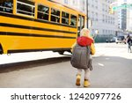 pupil with schoolbag with... | Shutterstock . vector #1242097726
