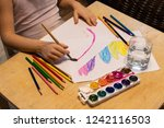 child paints with ink and... | Shutterstock . vector #1242116503