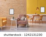 yellow sofa brick wall and... | Shutterstock . vector #1242131230
