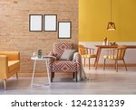 yellow sofa brick wall and... | Shutterstock . vector #1242131239