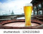 winter beer and retro barrel... | Shutterstock . vector #1242131863