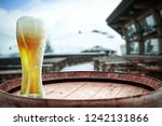 winter beer and retro barrel... | Shutterstock . vector #1242131866