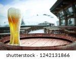 winter beer and retro barrel... | Shutterstock . vector #1242131866