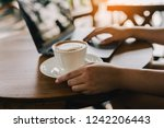 hot coffee on the wood table in ... | Shutterstock . vector #1242206443