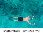 man with snorkel mask tuba and... | Shutterstock . vector #1242231790